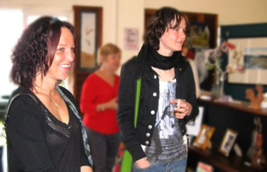 Visitors and artists enjoying the exhibition TEN at the Curious Art Gallery